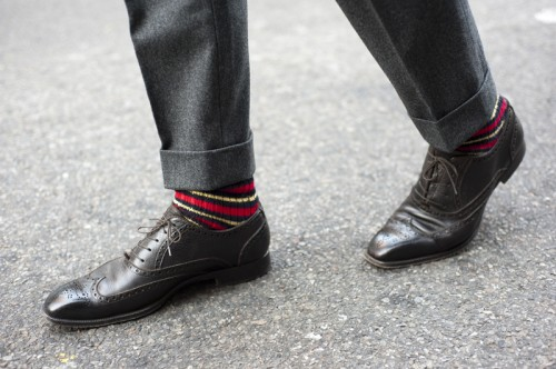 bold sock with gray suit